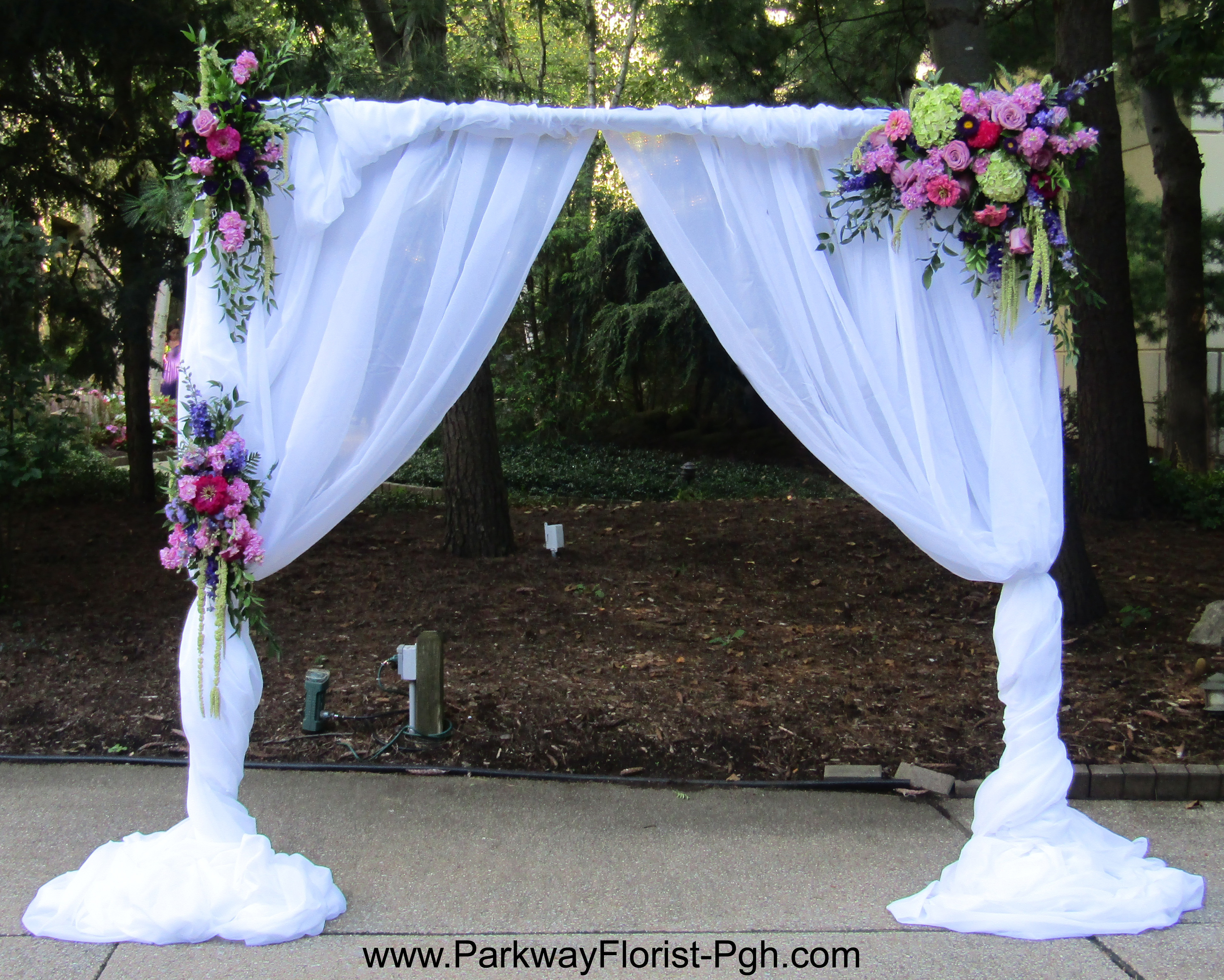Pipe and Drape with FLower Clusters