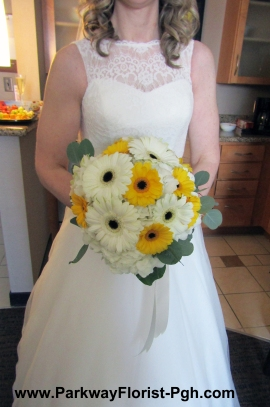 The Bride holding her bouquet.