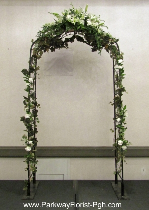 Black Arch Indoors White Flowers