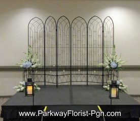 Candlelit rod iron screens - Ceremony Decor